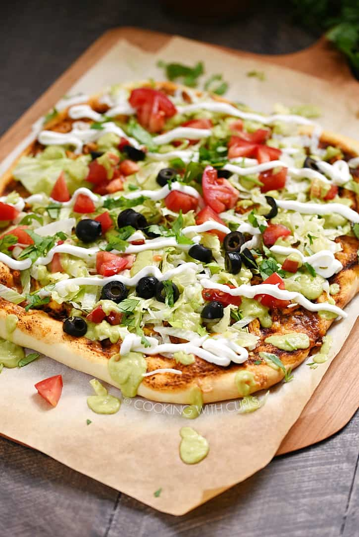 It's time to spice up pizza night with this amazing and simple Chicken Enchilada Pizza! cookingwithcurls.com