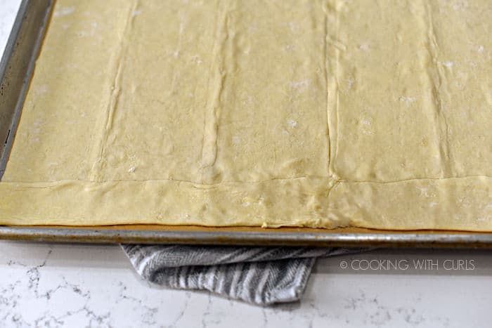 puff pastry sheets laid out on a parchment lined baking sheet.