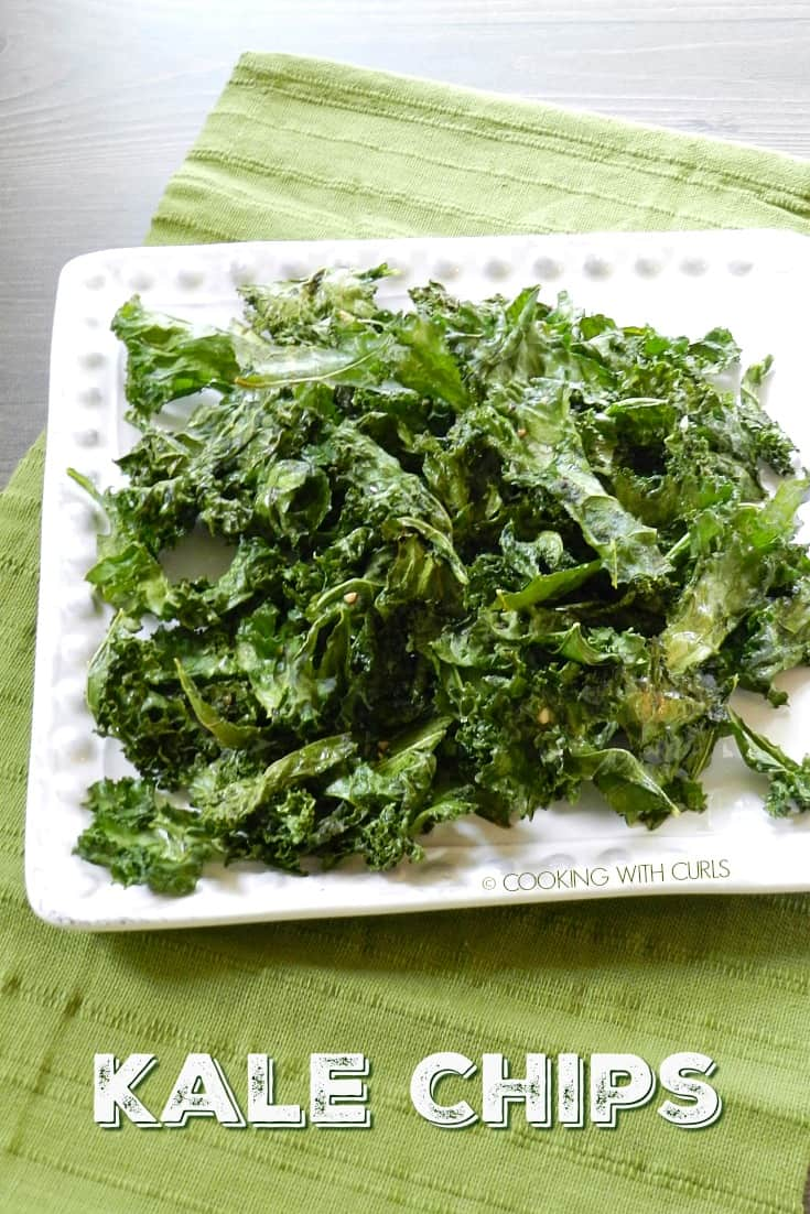 Homemade Kale Chips on a square, white plate