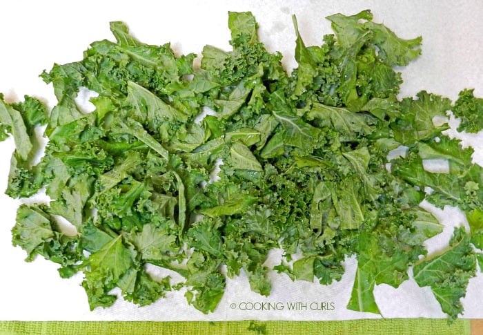 Rinsed kale drying on a paper towel