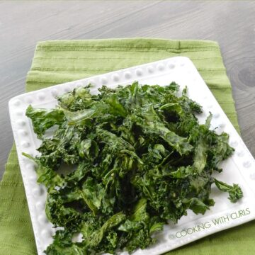 Kale Chips on a white plate sitting on a green towel