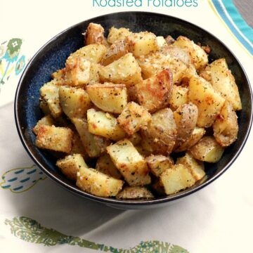 Crispy Herb Roasted Potatoes in a black bowl.
