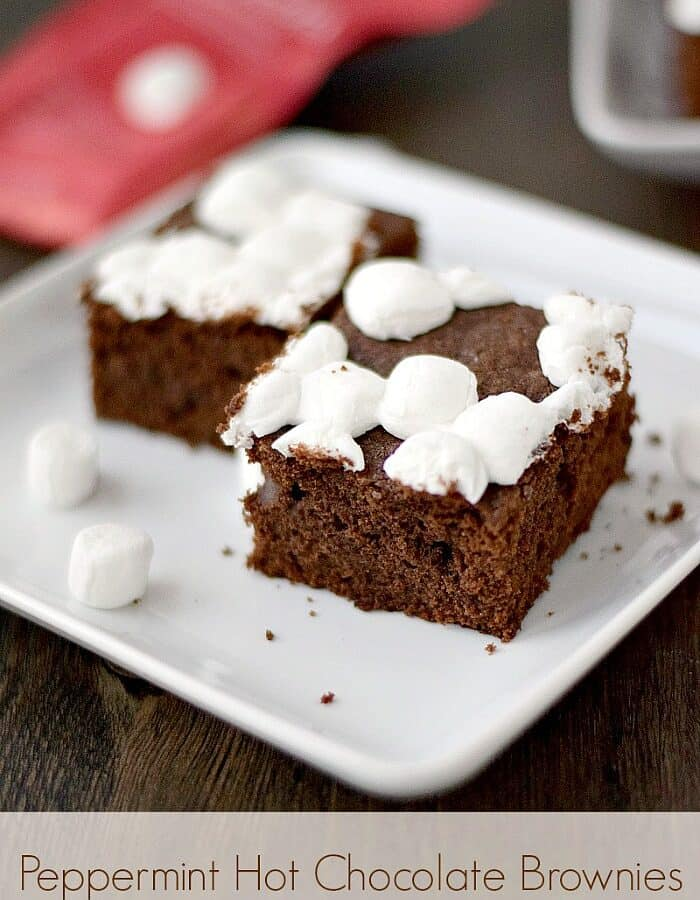 mini marshmallow topped brownies sitting on a square white plate
