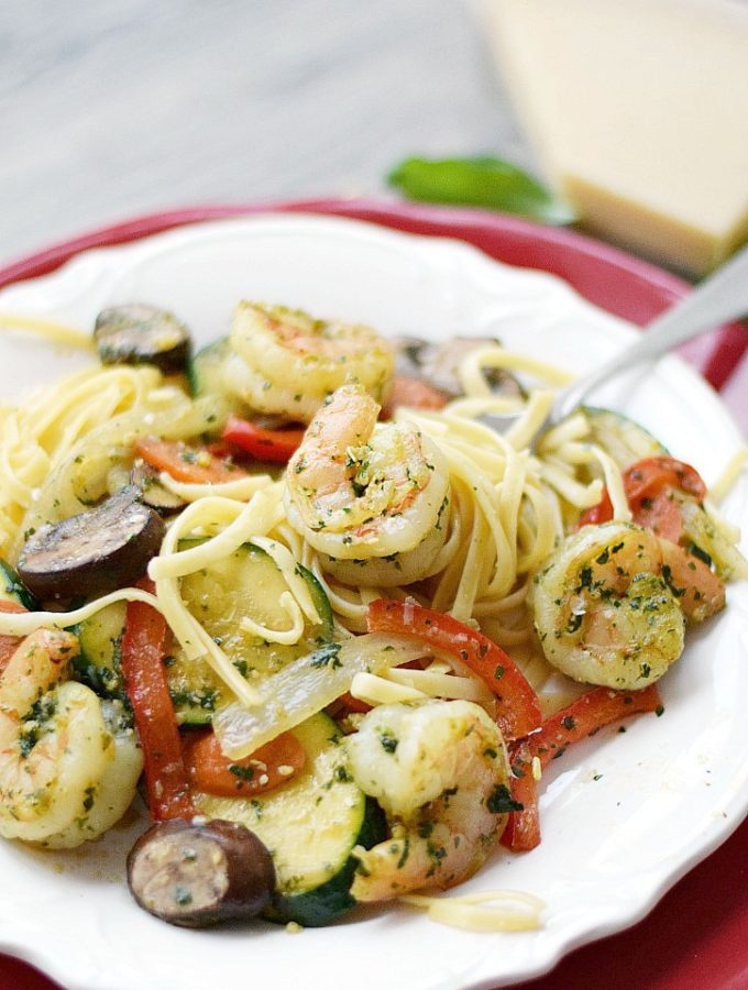 Shrimp Pesto with Pasta is loaded with vegetables and flavor for an easy weeknight meal! cookingwithcurls.com