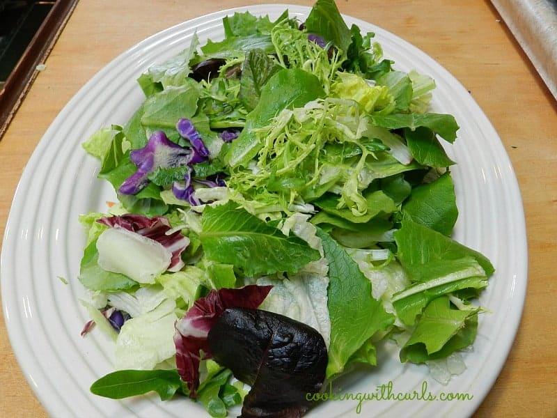 lettuce piled up on a serving platter