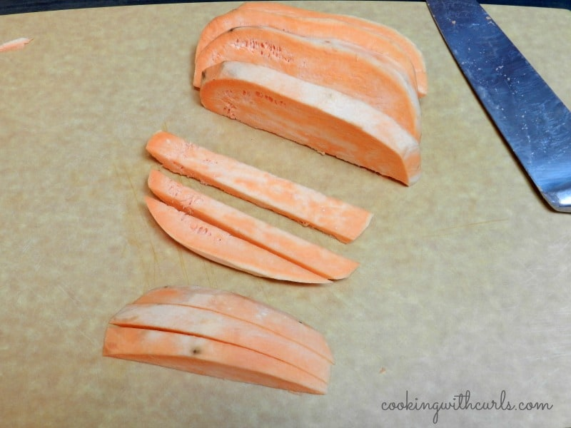 Sliced sweet potato on a cutting board