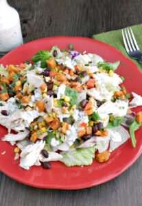 Southwest Chicken Salad for Fall topped with roasted sweet potato and corn salsa, and a chipotle ranch dressing