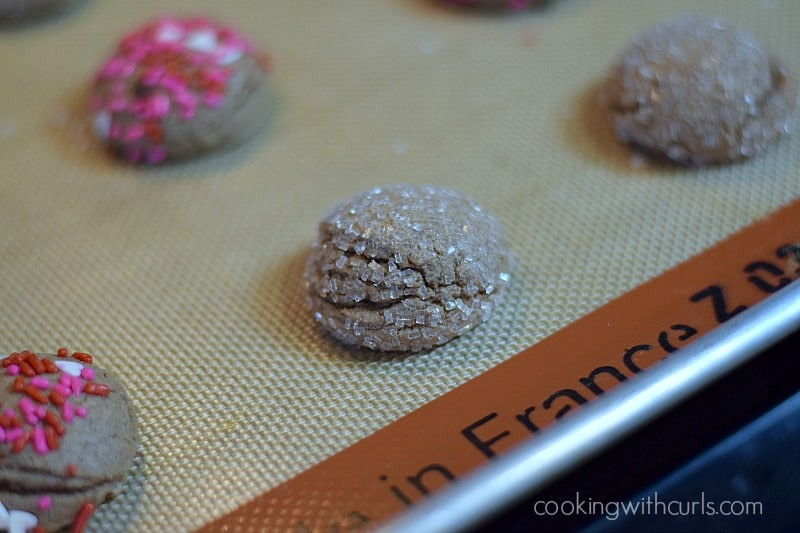 Chocolate Peanut Butter Kisses Cookies baked on a silicone lined baking sheet