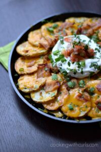 Irish Nachos served in a cast iron skillet sitting on a green napkin