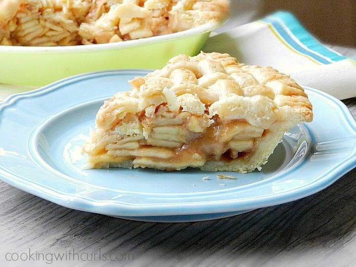 Lattice Top Apple Pie slice on a blue plate