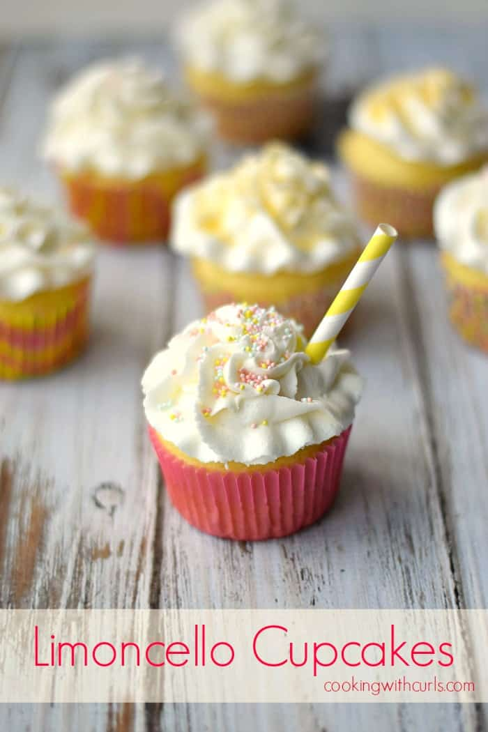 Limoncello Cupcakes sitting on a weathered white wood board