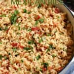 Mexican rice in a white cast iron skillet with title graphic across the top.