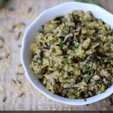 Savory Wild and Brown Rice Pilaf in a white bowl with title graphic running across the bottom of the image.