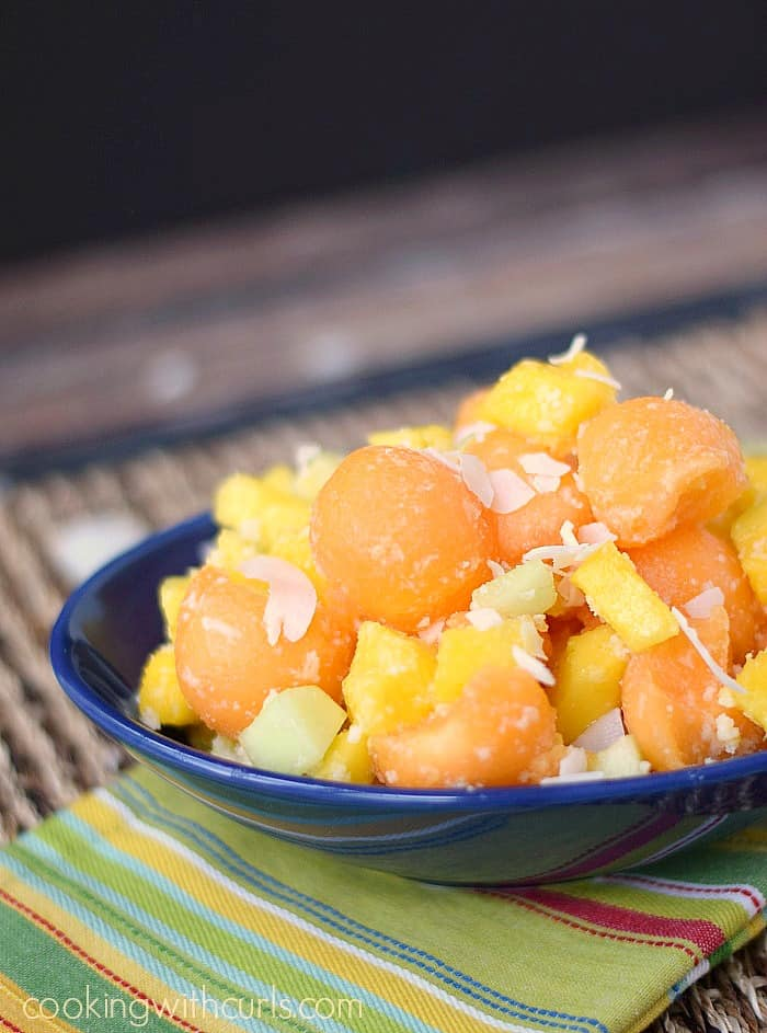 Tropical Cantaloupe Salad in an oval dark blue bowl