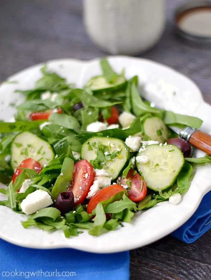 A fresh Greek Salad ready to be served with Creamy Feta Dressing! cookingwithcurls.com