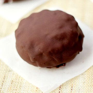 Two chocolate coated ice cream sandwiches.