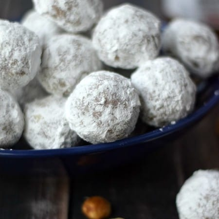A pile of Nocciolata Teacakes in a dark blue bowl