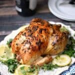 This Greek Roasted Chicken is crispy on the outside, tender and juicy on the inside and loaded with flavor! cookingwithcurls.com