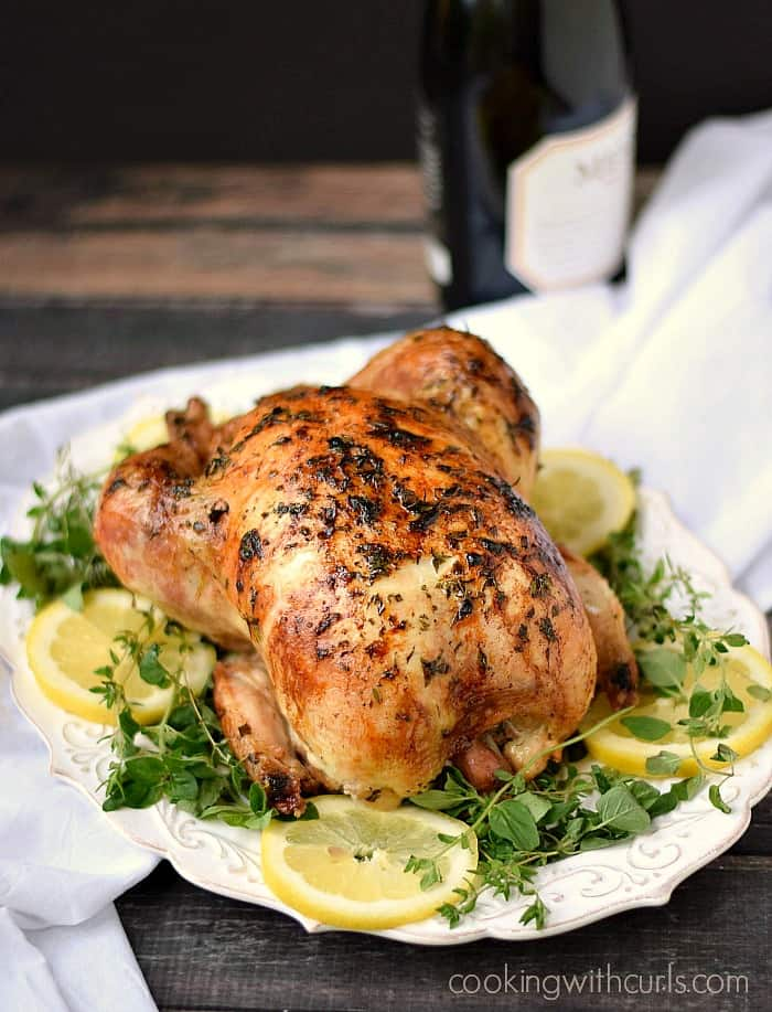 This Greek Roasted Chicken is tender and flavorful on the inside and crispy on the outside! cookingwithcurls.com
