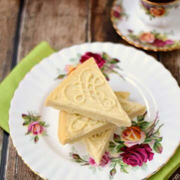Traditional Shortbread on a rose decorated plate beside a cup of tea