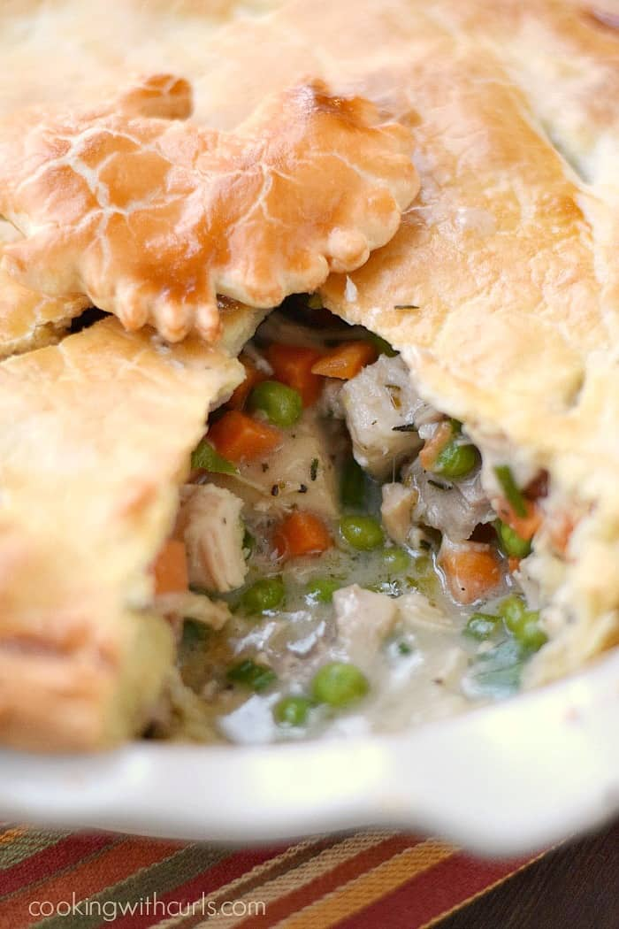 Chunks of turkey and lots of vegetables and a tender crust surround this delicious Turkey Pot Pie...and it's dairy-free too! cookingwithcurls.com
