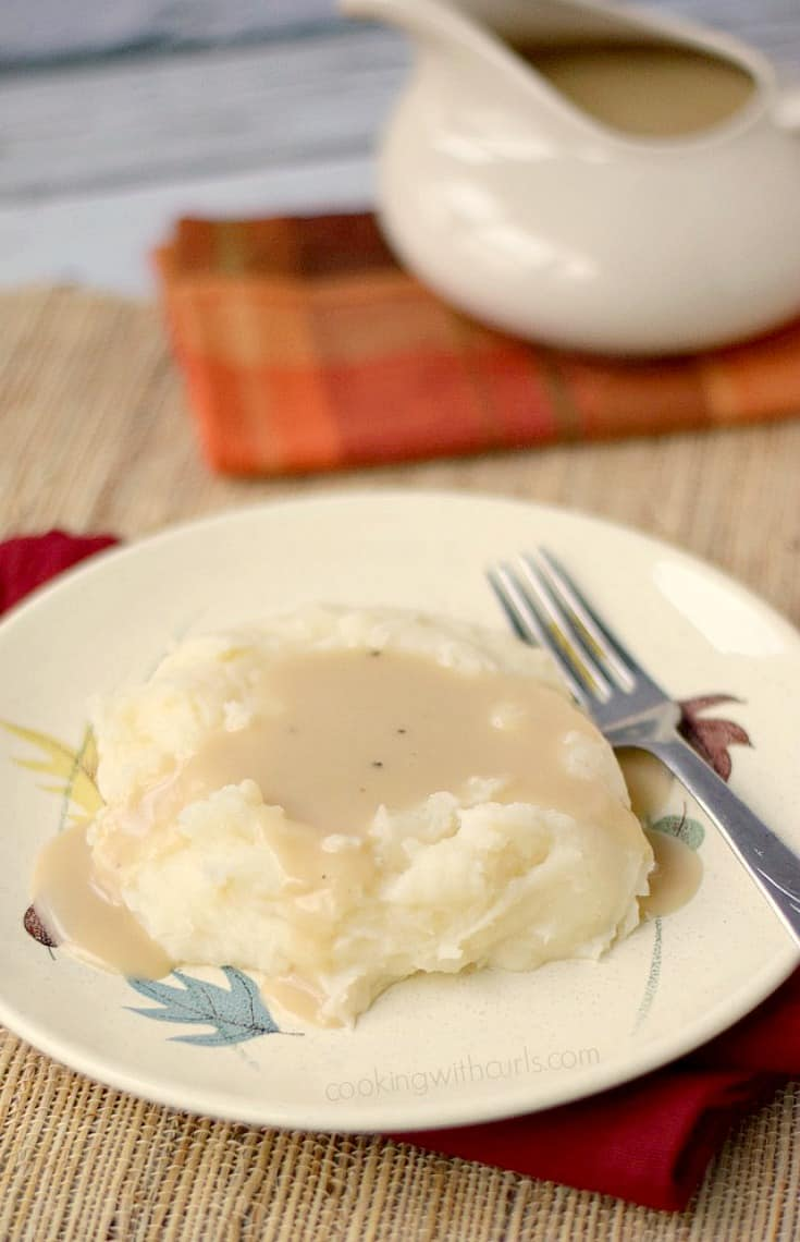 a plate of mashed potatoes topped with turkey gravy