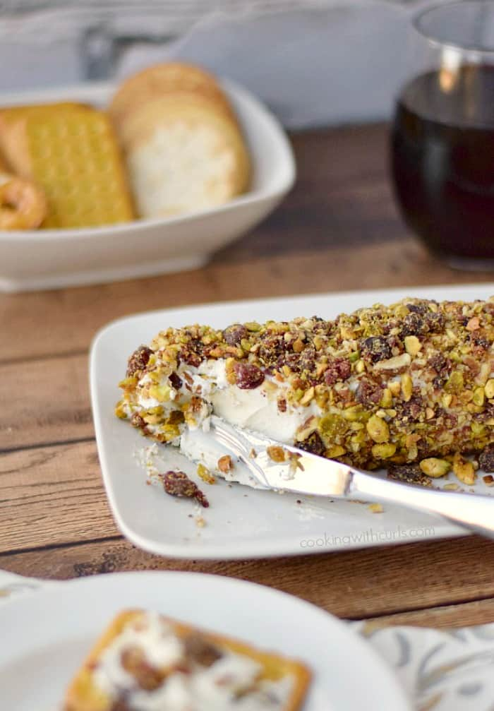 Cranberry Pecan Goat Cheese Log served with crackers makes the perfect holiday appetizer! cookingwithcurls.com