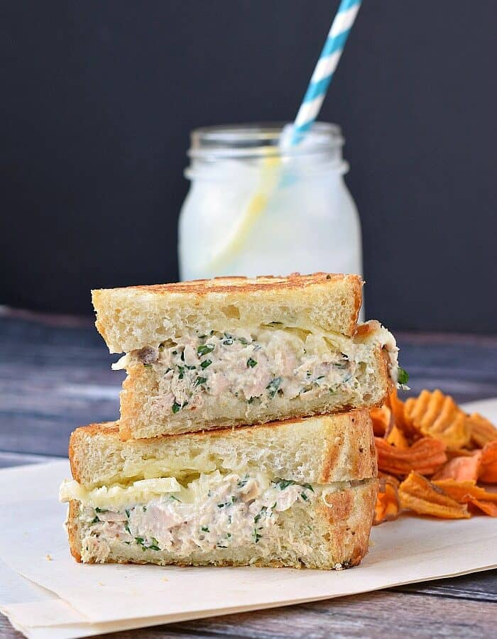 Wild-caught tuna, fresh lemon zest and juice are mixed with mayonnaise, tarragon, and Dijon mustard then topped with melted cheese and grilled sourdough for a mouth watering Gourmet Tuna Melt! cookingwithcurls.com