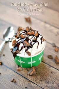 Graphic image for Touchdown Sundae Ice Cream Pie in a football cup and topped with broken candy bars