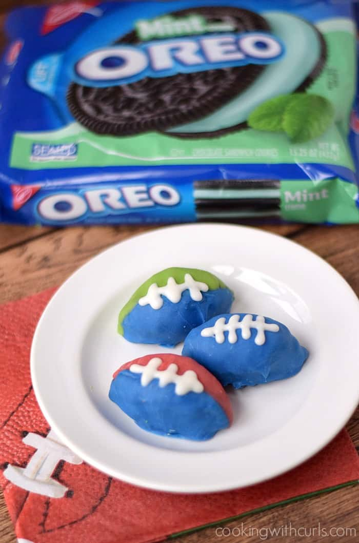 OREO Cookie Balls made in the shape of a football for the big game | cookingwithcurls.com #OREOCookieBalls #ad
