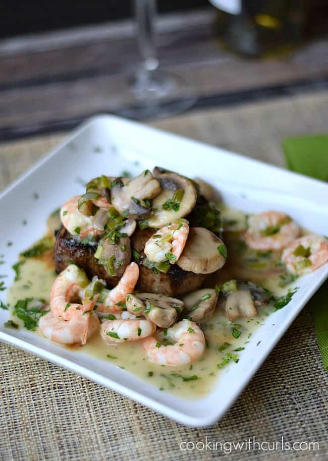 Beef-Tenderloin-with-Shrimp-and-Mushroom-Sauce on a square white plate.