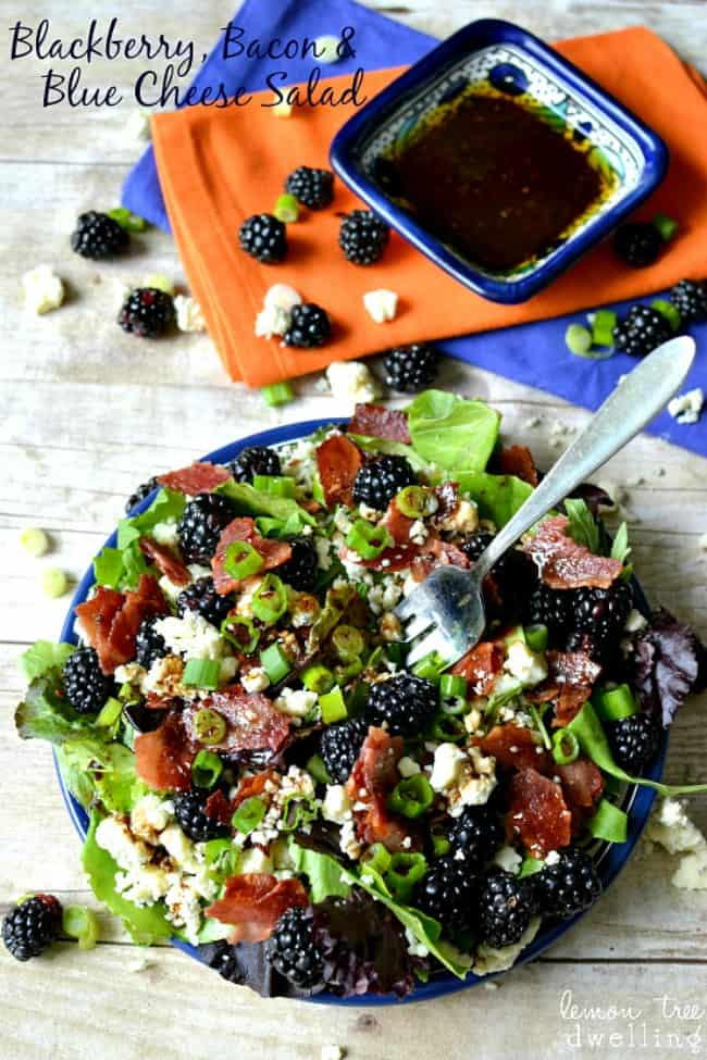 Blackberry-Salad on a blue platter with extra dressing on the side.