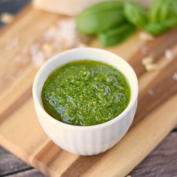 This traditional Basil Pesto is perfect mixed with pasta, spread on a sandwich, or used as a pizza topping! cookingwithcurls.com