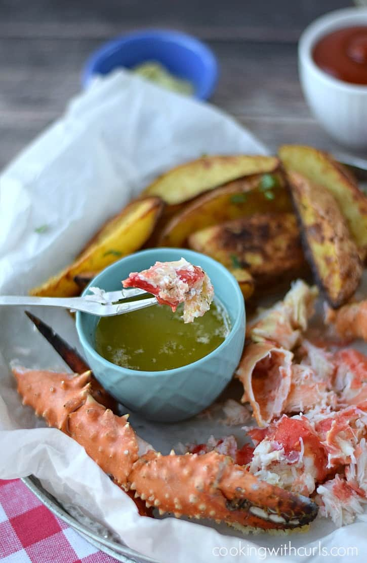 Wild Alaskan Crab Legs dipped in Garlic Herb Butter   cookingwithcurls.com #WildAlaskaSeafood #CleverGirls