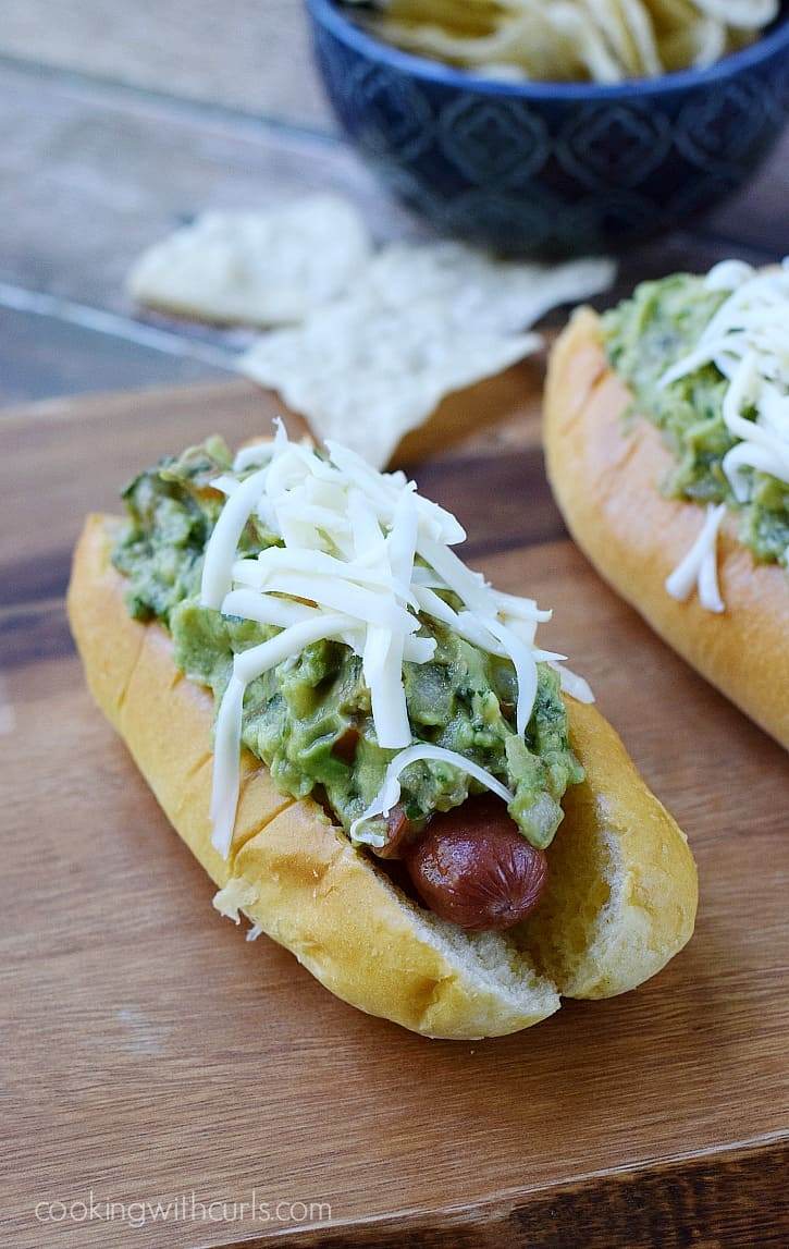California Dogs - all beef hot dogs wrapped in bacon and topped with guacamole and Monterey Jack cheese   cookingwithcurls.com