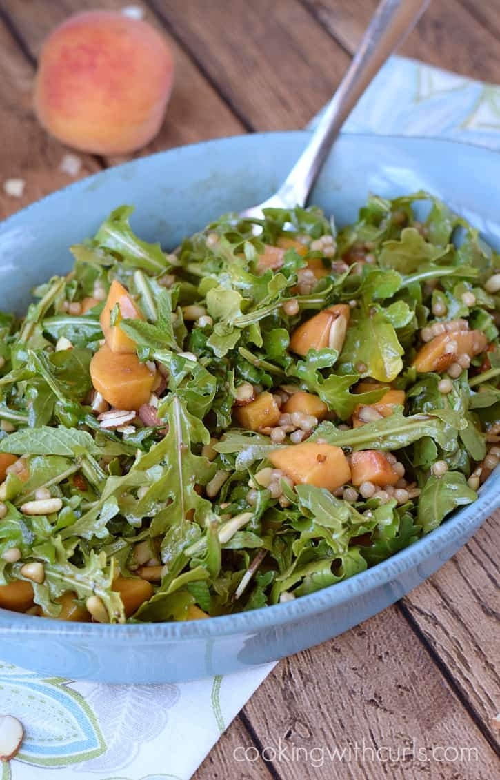 Celebrate summer with this light and refreshing Couscous Salad with Peaches and Arugula   cookingwithcurls.com