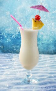 Classic Pina Colada a sweet tropical cocktial made with rum pineapple juice and coconut cream cookingwithcurls.com