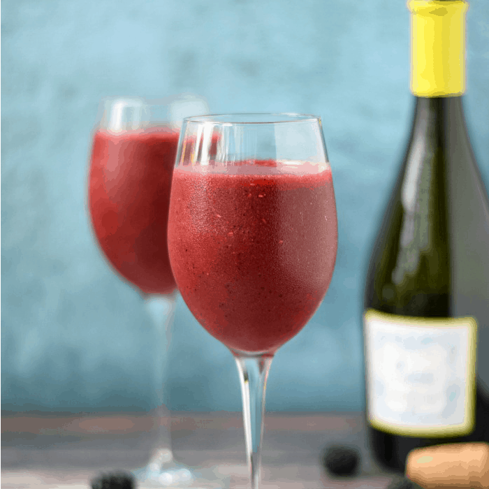 Blended berries and wine in two wine glass.