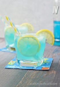 A Blue Lemonade Cocktail is the perfect beverage to cool you off this summer! cookingwithcurls.com