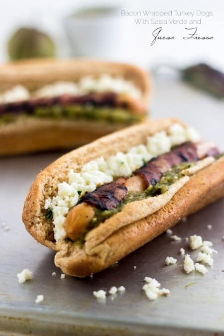 Bacon Wrapped Turkey Dogs with Salsa Verde and Queso Fresco