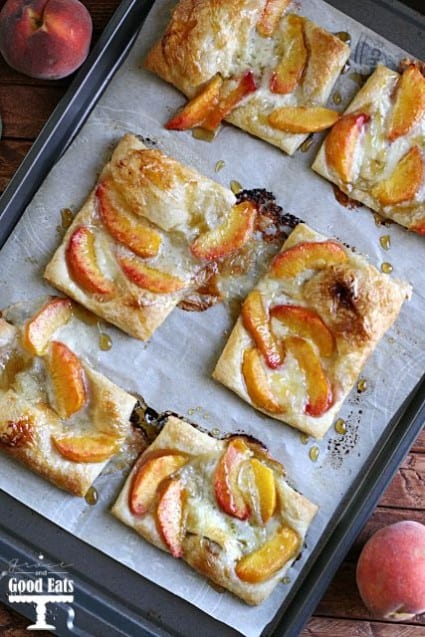 Puff pastry topped with peaches and brie, and drizzled with sweet honey