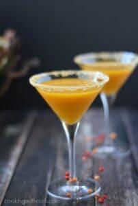 Two Pumpkintini cocktails in martini glasses