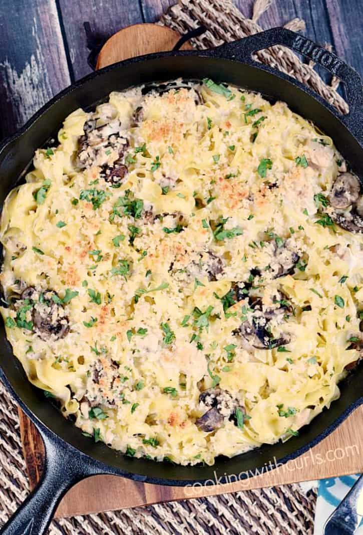 overhead view of a tuna noodle casserole in a cast iron skillet