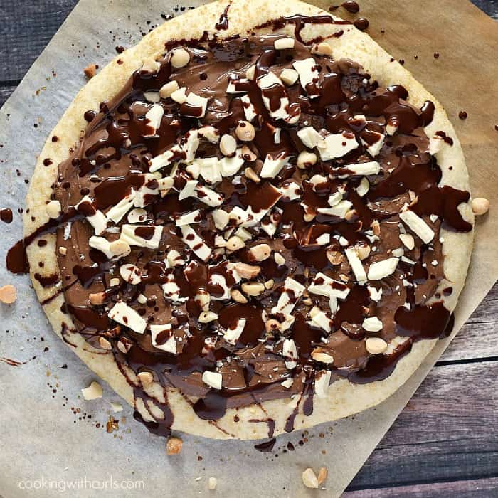 This rich and delicious Chocolate Hazelnut Pizza is guaranteed to be a hit with the family! cookingwithcurls.com
