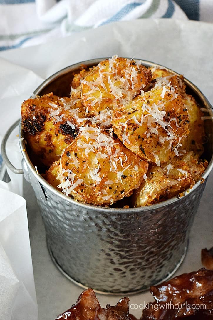 Tender potatoes seasoned with basil, oregano, and fresh Parmesan cheese make these Crispy Italian Roasted Potatoes a much better choice than French fries   cookingwithcurls.com