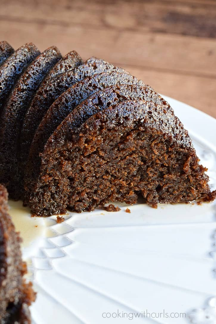 Moist and tender Guinness Gingerbread topped with a Guinness glaze for a twist on an old holiday tradition | cookingwithcurls.com