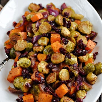Oven Roasted Brussels Sprouts and Squash with Dried Cranberries on a large platter.