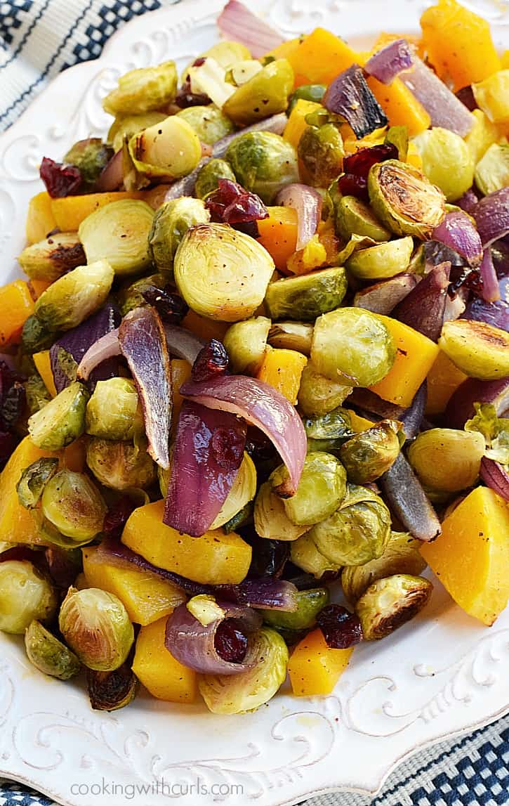 Roasted Brussels Sprouts and Butternut Squash with Dried Cranberries make the perfect side dish | cookingwithcurls.com