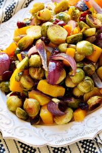 Roasted Brussels Sprouts, Squash and Cranberries on a white serving platter