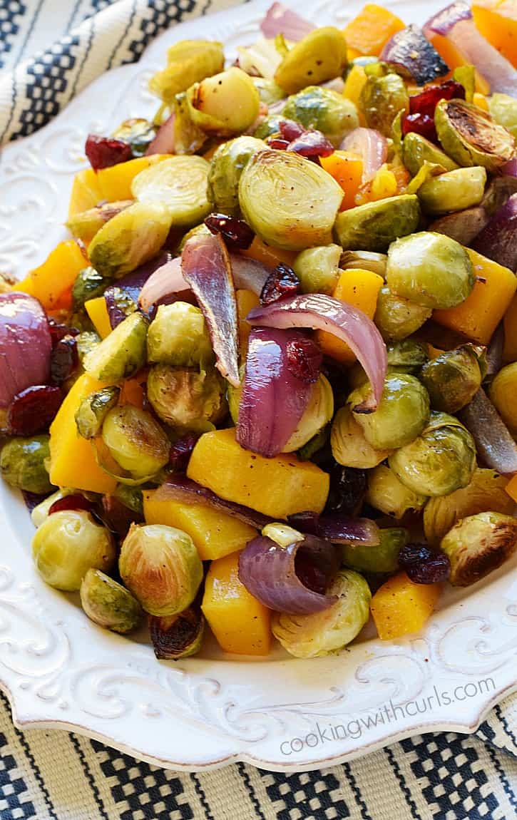 Roasted Brussels Sprouts and Squash with Dried Cranberries comes together to make the perfect side dish cookingwithcurls.com